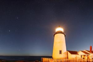 The Night Sky over the Pemaquid Point Lighthouse. the Brightest Point Is Planet Jupiter by Babak Tafreshi