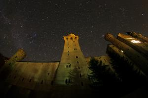 The Night Sky with a Meteor and the Milky Way Above the World-Famous Neuschwanstein Castle by Babak Tafreshi