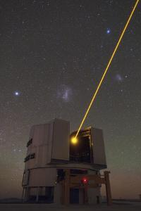The Very Large Telescope Sending a Laser Beam to the Atmosphere for Adaptive Optics Operation by Babak Tafreshi