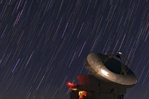Time-Exposure of Star Trails Above a Radio Dish by Babak Tafreshi