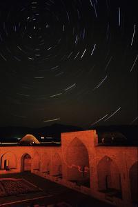 Time-Exposure of Star Trails around the North Celestial Pole over a Historic Caravansary, in Iran by Babak Tafreshi