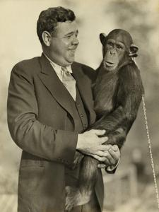 Babe Ruth, Holding Mike, a Chimpanzee at the St. Louis Zoological Park. Oct. 10, 1928