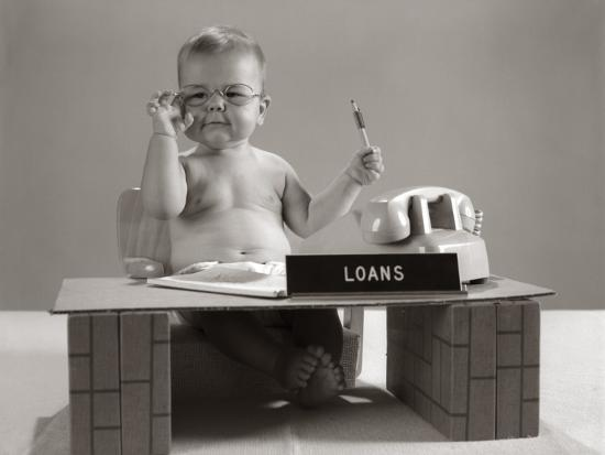 Baby At Desk Playing Loan Officerby H Armstrong Roberts