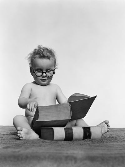 Baby Boy is Wearing Round Glasses While Reading a Very Large Book-H^ Armstrong Roberts-Photographic Print