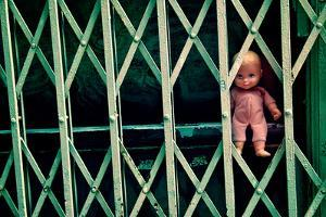 Baby Doll Through Security Fence NYC