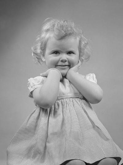 Baby Girl Smiling with Hands Next to Face--Photographic Print