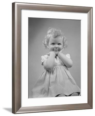 Baby Girl Smiling with Hands Next to Face--Framed Photographic Print