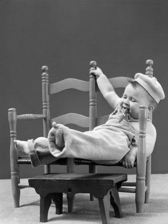 https://imgc.artprintimages.com/img/print/baby-in-corduroy-overalls-and-cap-smoking-cigar-and-lounging-in-2-seated-chair_u-l-q10br7y0.jpg?p=0