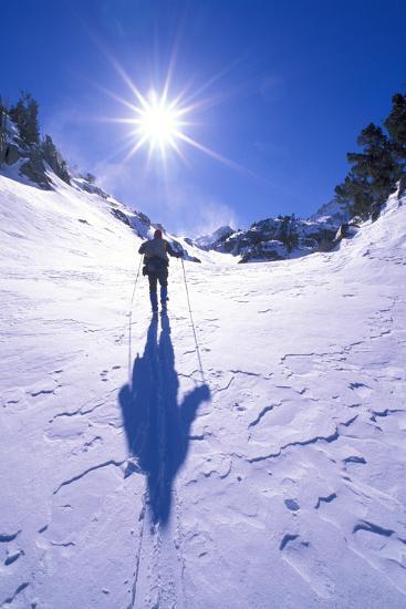 Backcountry skier crossing wind blown snow near Treasure Lakes, John Muir Wilderness, California-Russ Bishop-Photographic Print