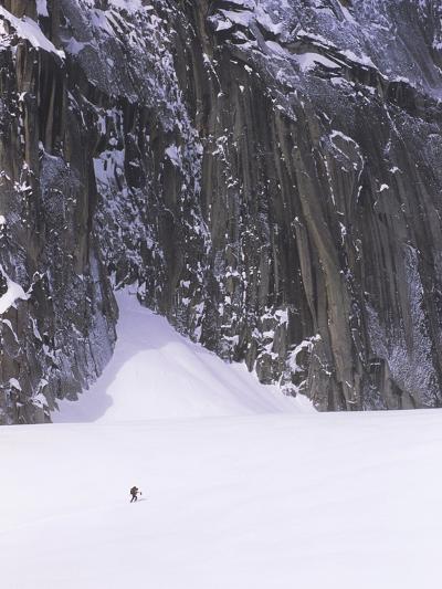 Backcountry Skier Underneath Snowpatch Spire, Bugaboos, British Columbia, Canada.-Chris Joseph-Photographic Print