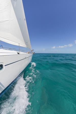 https://imgc.artprintimages.com/img/print/bahamas-exuma-island-sailboat-under-sail-in-ocean_u-l-pyq7tq0.jpg?p=0