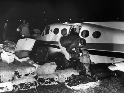 Bales of Marijuana Spill Out from a Crashed Cessna Plane, 1978--Photographic Print