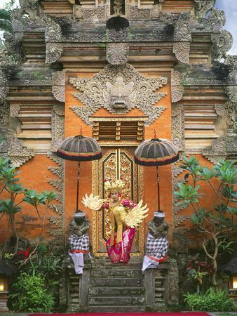 https://imgc.artprintimages.com/img/print/balinese-dancer-wearing-traditional-garb-near-palace-doors-in-ubud-bali-indonesia_u-l-p23yrf0.jpg?p=0