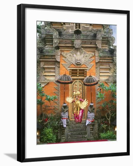 Balinese Dancer Wearing Traditional Garb Near Palace Doors in Ubud, Bali, Indonesia-Jim Zuckerman-Framed Photographic Print