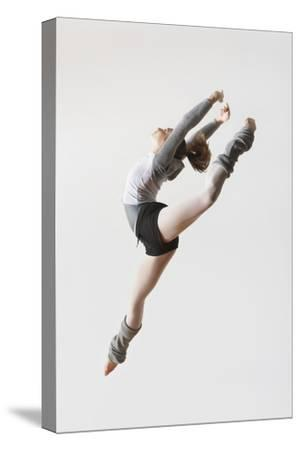Ballerina Leaping in Mid-Air