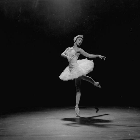 Ballerina Margot Fonteyn in White Costume Balanced on One Toe While Dancing Alone on Stage-Gjon Mili-Premium Photographic Print