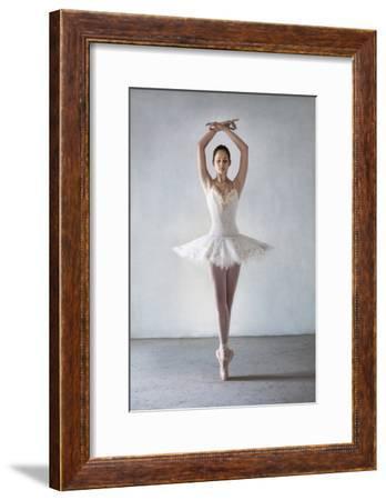 Ballerina Posing in Tutu on Points-Dimitri Otis-Framed Photographic Print