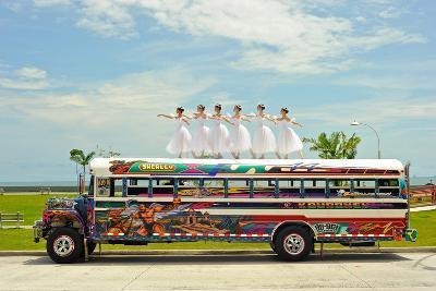 Ballerinas Dance on Top of a Diablo Rojo Bus on La Cinta Costera, Panama's Coastal Highway-Kike Calvo-Premium Photographic Print