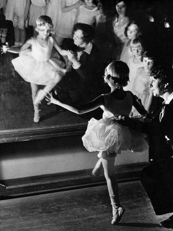 https://imgc.artprintimages.com/img/print/ballet-teacher-advising-little-girl-and-group-of-dancers-at-ballet-dancing-school-look-on_u-l-p3lwyr0.jpg?p=0