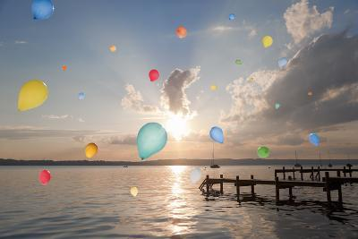 Balloons Floating over Still Lake-Henglein and Steets-Photographic Print