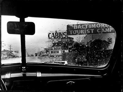 https://imgc.artprintimages.com/img/print/baltimore-washington-stretch-of-u-s-highway-is-a-clutter-of-signs-through-rain-covered-windshields_u-l-p43mra0.jpg?p=0