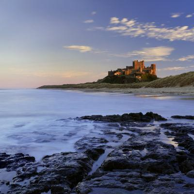 Bamburgh Castle Bathed in Warm Evening Light, Bamburgh, Northumberland, England, United Kingdom-Lee Frost-Photographic Print