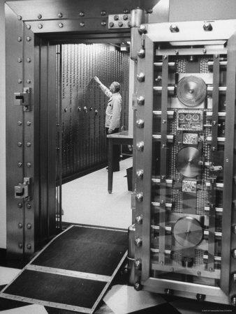 Bank Employee Selecting a Safety Deposit Box for a Customer Inside Vault Area-Bob Gomel-Photographic Print