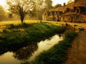 Morning Mist on Rack Isle Outside Weavers' Cottages, Arlington Row, Bibury, United Kingdom by Barbara Van Zanten
