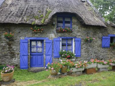 Thatched Cottage with Blue Doors, Windows and Pots of Geraniums Near Marzan