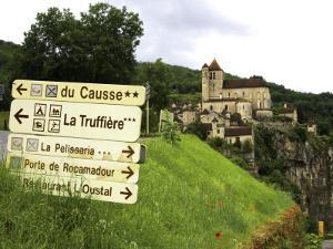 Tourist Signs Outside Village of St. Cirq Lapopie by Barbara Van Zanten