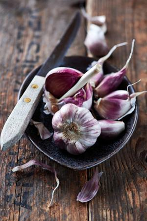 Garlic Bulbs and Cloves in a Ceramic Dish by barbaradudzinska