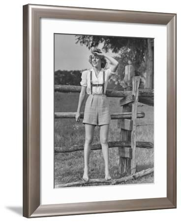 Barefoot Woman in Shorts Standing on Wooden Fence on Meadow-George Marks-Framed Photographic Print