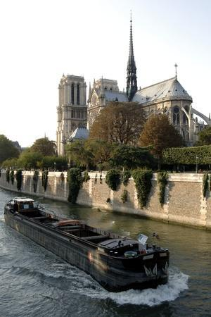 https://imgc.artprintimages.com/img/print/barge-passing-over-waters-of-seine-near-southeast-side-of-cathedral-of-notre-dame-de-paris-12th-14_u-l-puwdmy0.jpg?p=0