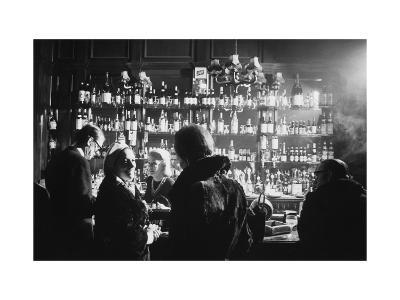 Barmaid in Smoky Pub--Photographic Print