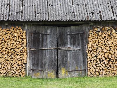 Barn Door Surrounded by Firewood Stacks-Keenpress-Photographic Print