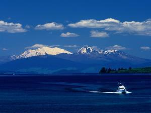 Boat Sailing with Mt. Ruapehu, Mt. Ngauruhoe and Mt. Tongariro in Background, New Zealand by Barnett Ross