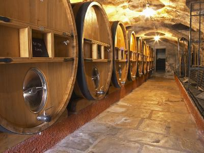 Barrels of Wine Aging in Cellar, Chateau Vannieres, La Cadiere d'Azur-Per Karlsson-Photographic Print