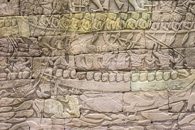 Bas relief stone carvings ankorian era temple ruins banteay