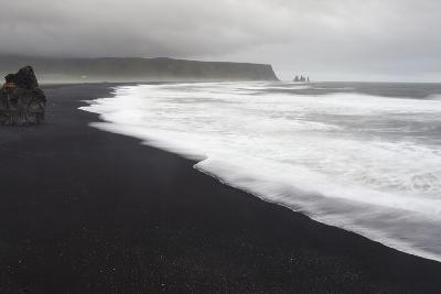 Basalt Column Rises from Black Sand Beach on Rainy Day, Vik, Iceland-Jaynes Gallery-Photographic Print