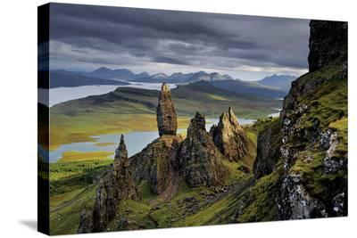 Basalt pinnacles loom over the Sound of Raasay.-Jim Richardson-Stretched Canvas Print