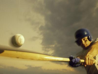 Baseball Player Swinging a Bat--Photographic Print