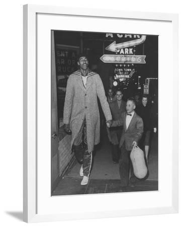 Basketball Player Wilt Chamberlain Walking with an Unidentified Child--Framed Premium Photographic Print