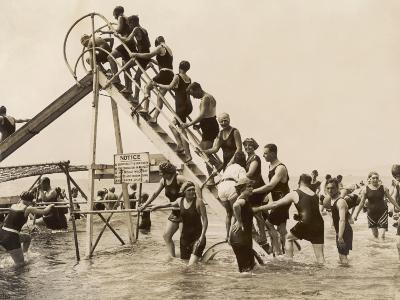 Bathers at Bournemouth Wait Their Turn for a Go on the Water Chute--Photographic Print