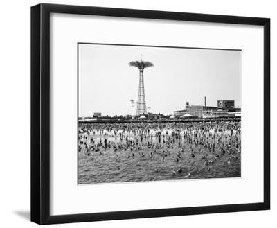 Bathers Enjoying Coney Island Beaches. Parachute Ride and Steeplechase Park Visible in the Rear-Margaret Bourke-White-Framed Premium Photographic Print