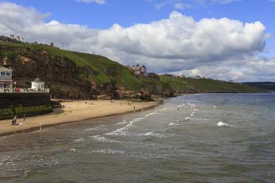 Bathers on West Cliff Beach, Backed by Grassy Cliffs in Summer, Whitby, North Yorkshire, England-Eleanor Scriven-Photographic Print