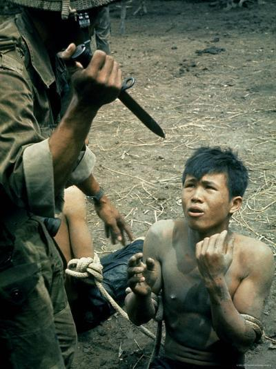 Bayonet Wielding South Vietnamese Soldier Menacing Captured Viet Cong Suspect During Interrogation-Larry Burrows-Photographic Print