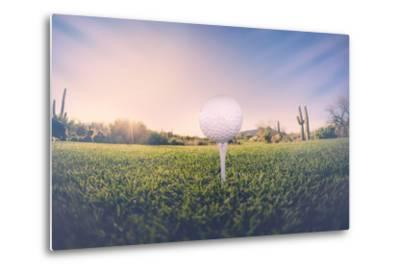 Super Wide Angle View of Golf Ball on Tee with Desert Fairway and Stunning Arizona Sunset in Backgr