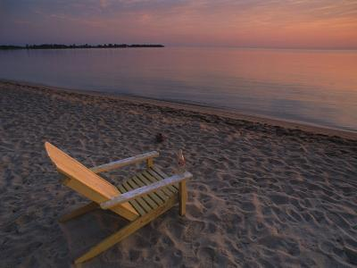 Beach Chair Facing the Water at Twilight-Bill Hatcher-Photographic Print