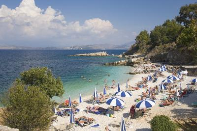 Beach Crowded with Holidaymakers, Kassiopi, Corfu, Ionian Islands, Greek Islands, Greece, Europe-Ruth Tomlinson-Photographic Print