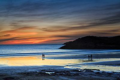 Beach Goers Enjoy the Last Rays of Sunlight at White Sands Beach in St. Davids, Wales-Frances Gallogly-Photographic Print